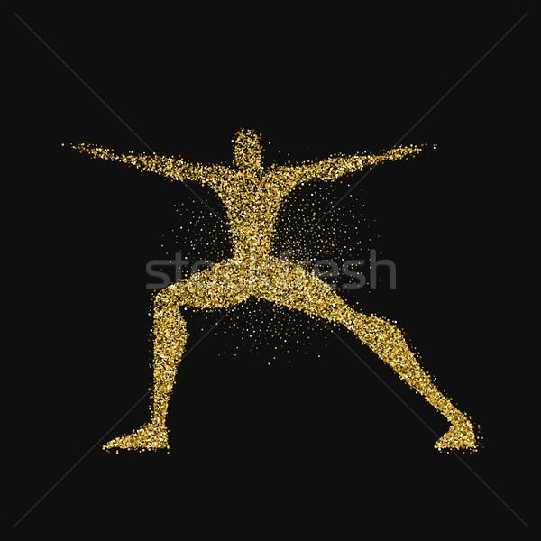 Homme pose de yoga silhouette or glitter poussière Photo stock © cienpies
