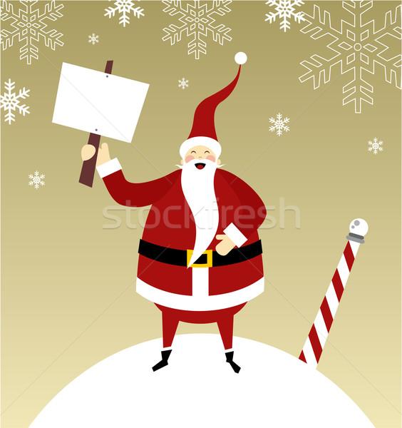 Happy Santa Claus on a snow mountain  Stock photo © cienpies