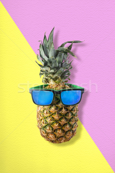 Pineapple with sunglasses for tropical summer idea Stock photo © cienpies