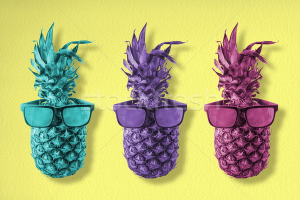 Colorful pineapple fruit with hipster sunglasses Stock photo © cienpies