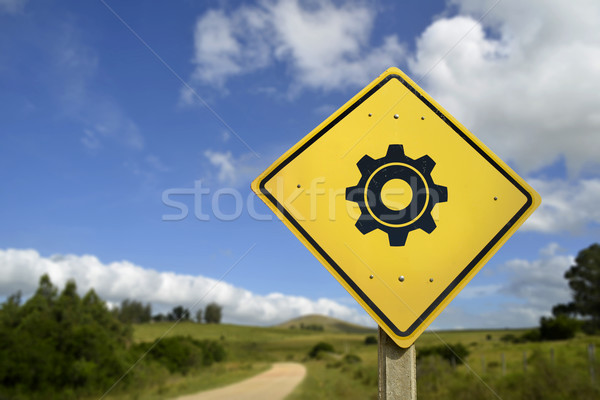 Support in rural area concept road sign gear icon Stock photo © cienpies