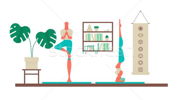 Woman and man doing yoga poses at home Stock photo © cienpies