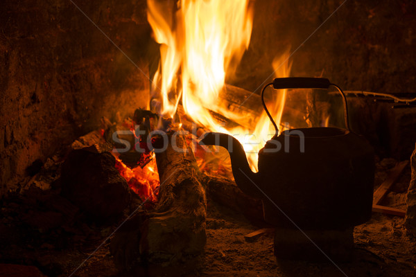 Fire fireplace kettle wood winter holiday Stock photo © cienpies