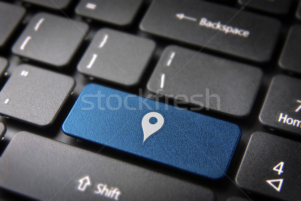 Blue geo location keyboard key, technology background Stock photo © cienpies