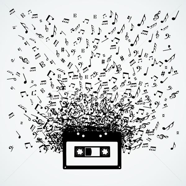 Note musicali fuori cassette isolato design casuale Foto d'archivio © cienpies
