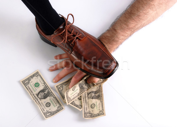 Shoe crushing a hand that holds money. White background Stock photo © cienpies