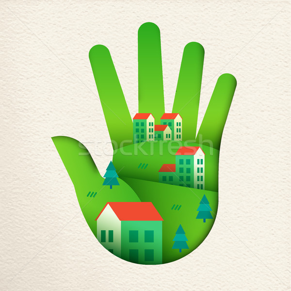 Eco friendly city in green paper cut hand  Stock photo © cienpies