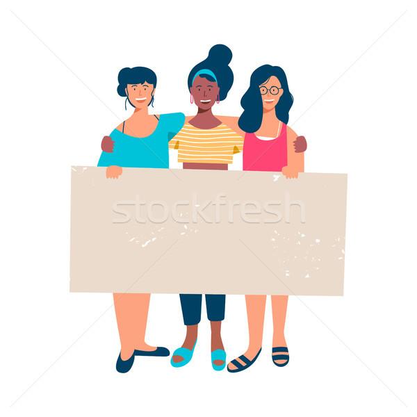 Nő csoport tart üres szalag szöveg Stock fotó © cienpies