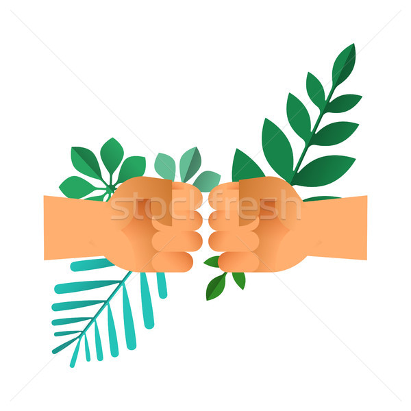 Fist bump hands with green leaf for nature help Stock photo © cienpies