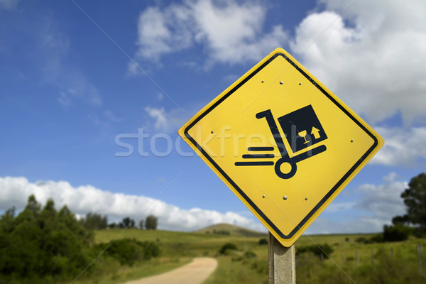 Shipping concept delivery box cart on road sign Stock photo © cienpies
