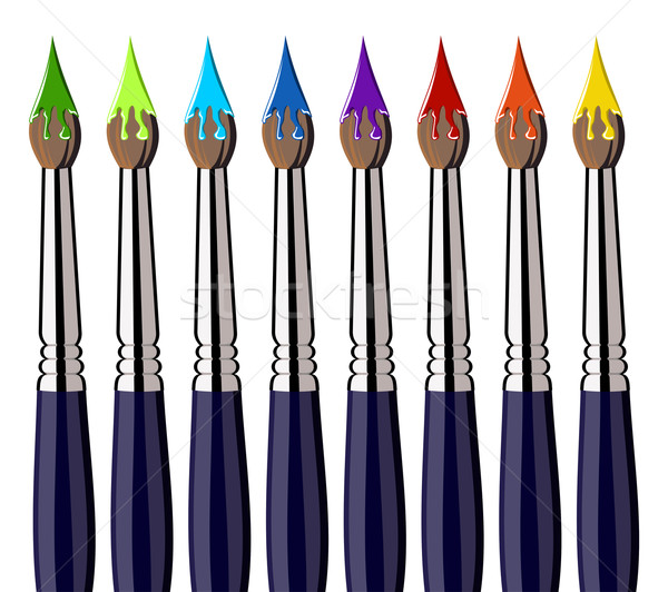 Aligned paint brushes with colors on the bristles Stock photo © cienpies