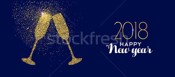 Boldog új évet arany csillámlás üveg pirítós pezsgő Stock fotó © cienpies