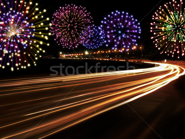 Happy New Year fireworks city cars highway Stock photo © cienpies