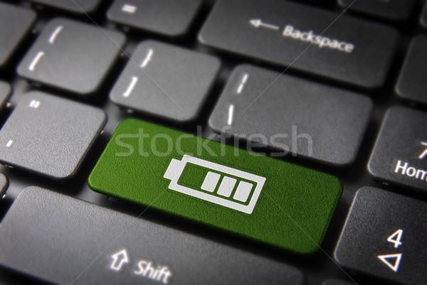 Green keyboard key battery status, technology background Stock photo © cienpies