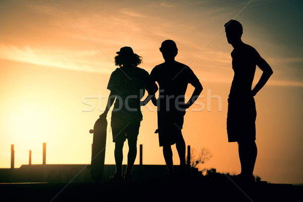 Teen boys silhouette at skate park on summer Stock photo © cienpies