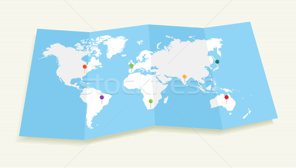 World map with GPS location pushpins EPS10 file. Stock photo © cienpies