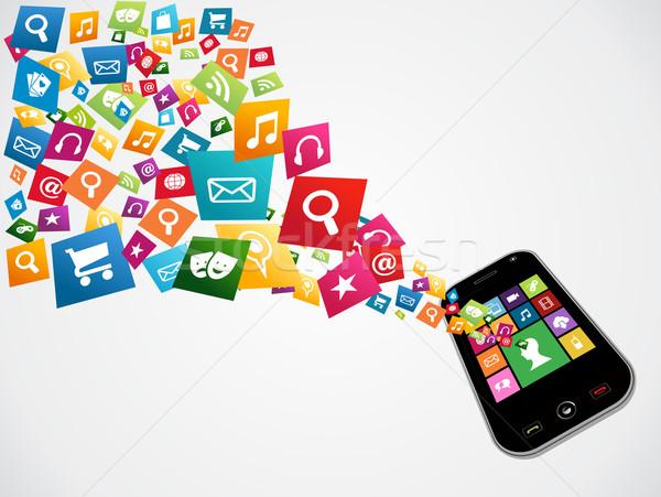 Smartphone download applications Stock photo © cienpies