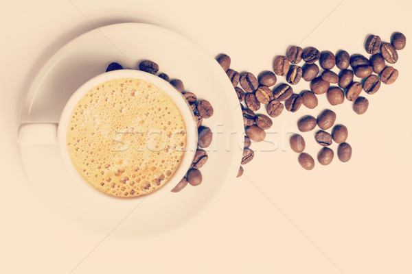 Vintage cup of coffee and roasted beans Stock photo © cienpies