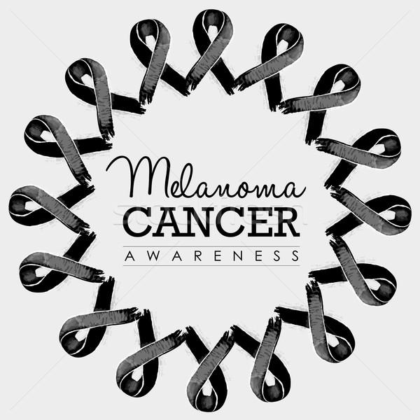 Melanoma cancer awareness ribbon design with text Stock photo © cienpies