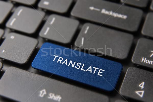 Language translation support on computer key Stock photo © cienpies