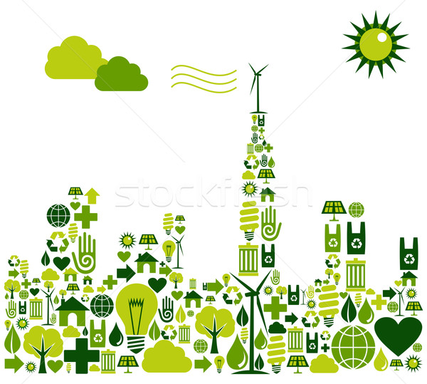 Green City silhouette with environmental icons Stock photo © cienpies