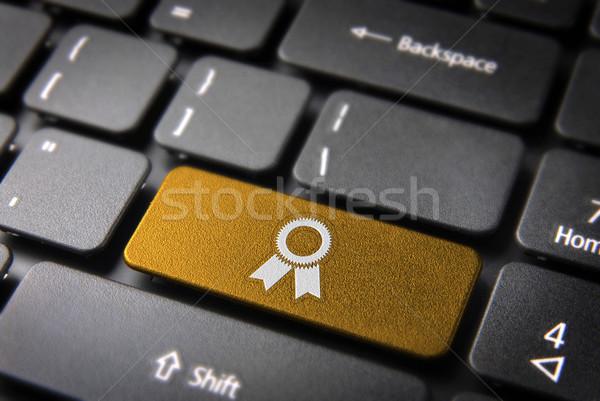 Gold ribbon keyboard key, business background Stock photo © cienpies