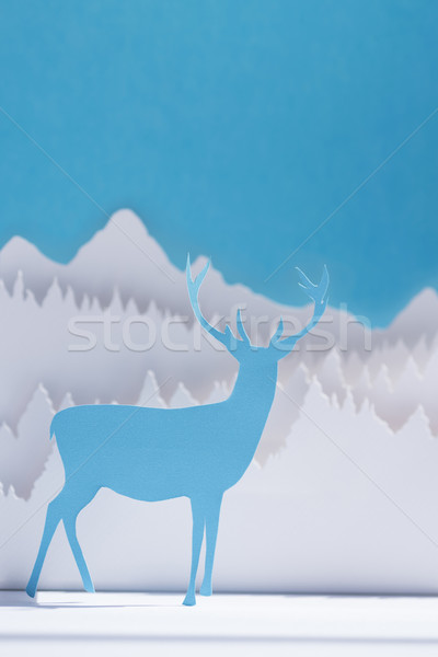 Stock photo: Paper cut deer handmade craft holiday blue card