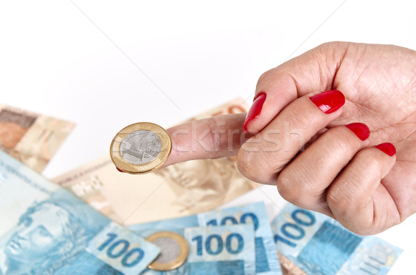 Woman's hand and Brazilian money Stock photo © cifotart