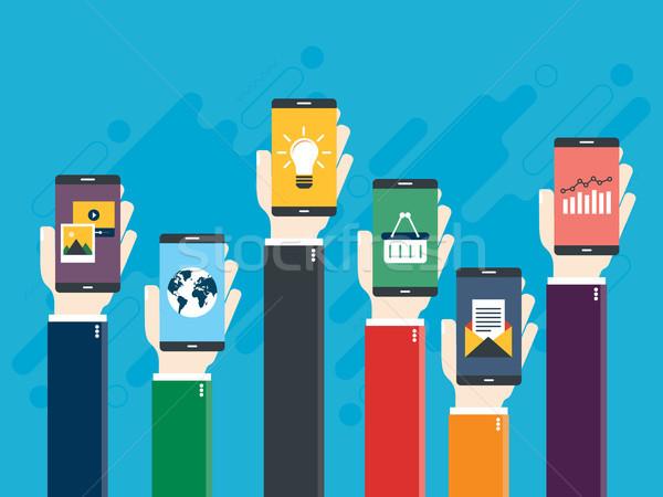 Stockfoto: Opgeheven · handen · smart · telefoons · iconen · ecommerce