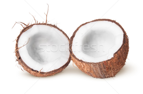 Two halves of coconut lying next Stock photo © Cipariss