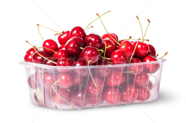 Red juicy sweet cherries in a plastic tray rotated Stock photo © Cipariss
