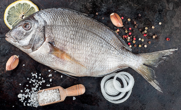 Dorado fish on pan with spices Stock photo © Cipariss