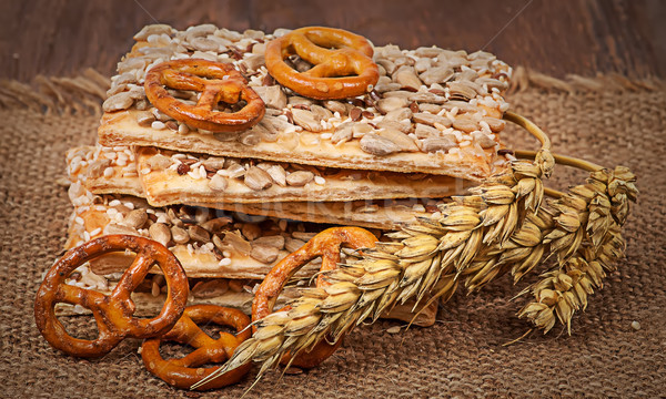 Pile cereal cookies with seeds and wheat ears on sacking Stock photo © Cipariss