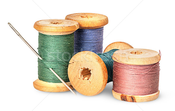 Needle and multicolored thread on wooden spool Stock photo © Cipariss