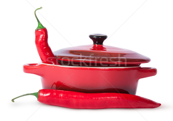 Two red chili peppers and saucepan with lid Stock photo © Cipariss