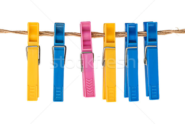 Multicolored plastic clothespins on a rope Stock photo © Cipariss