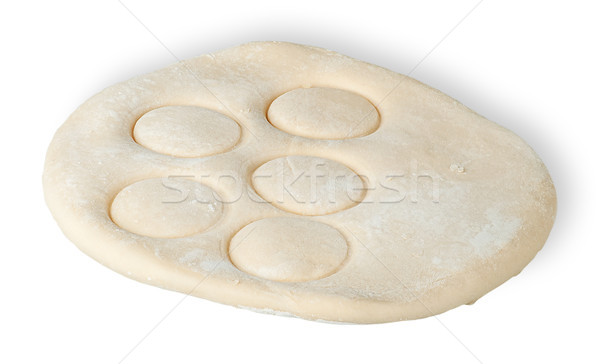 Roll dough with pressed through circles Stock photo © Cipariss