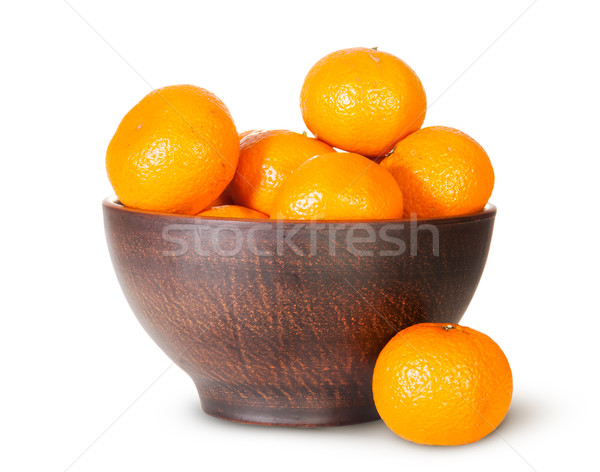 Tangerines In A Ceramic Bowl And One Near Stock photo © Cipariss