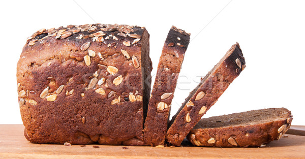 Unleavened bread with seeds sliced on cutting board Stock photo © Cipariss