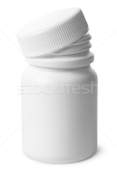 Single plastic bottle with cover removed for pills Stock photo © Cipariss
