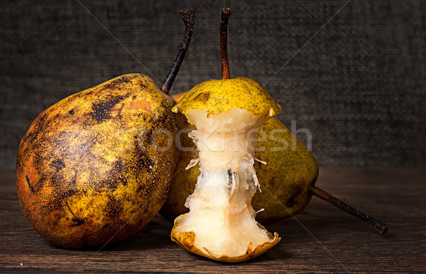 Two pears and stub standing on wooden table Stock photo © Cipariss