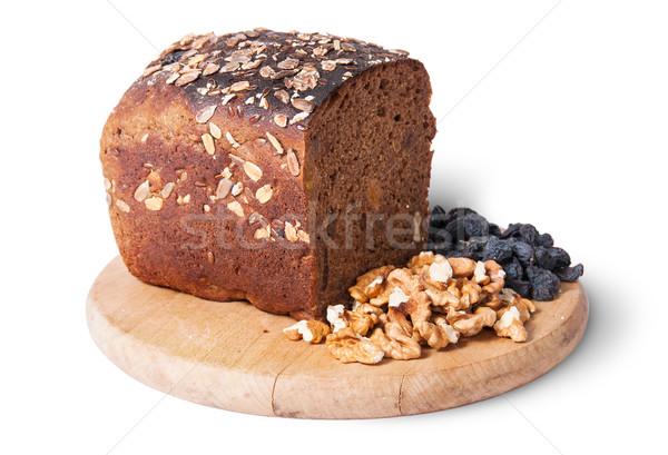 パン 種子 木板 レーズン ナッツ 孤立した ストックフォト © Cipariss
