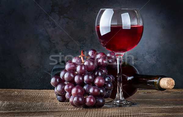 Glass wine with grapes and bottle Stock photo © Cipariss
