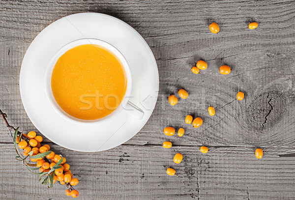 Sea buckthorn juice on a wooden table Stock photo © Cipariss
