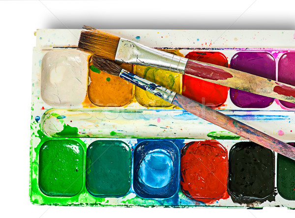 Stock photo: Closeup of watercolor paints set and brushes