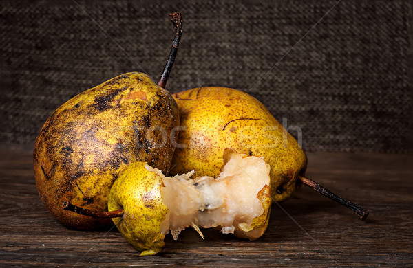 Two pears and stub on wooden table Stock photo © Cipariss