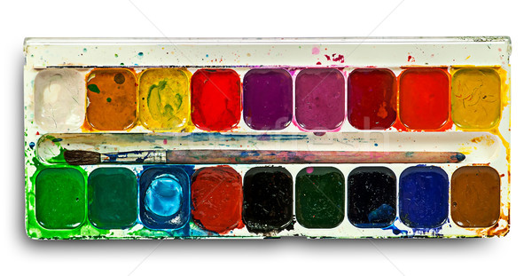 Stock photo: Watercolor paints set and brush