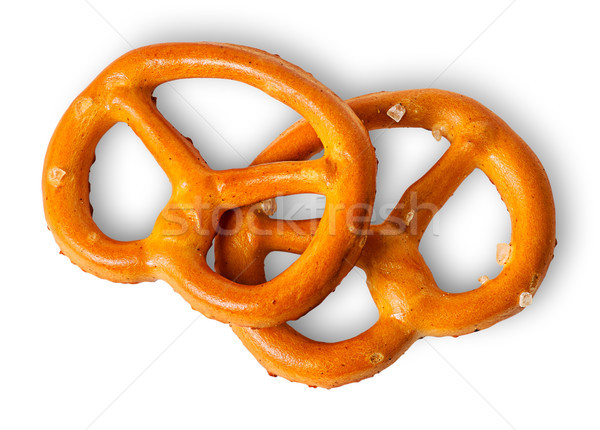Two crunchy pretzels with salt on each other Stock photo © Cipariss