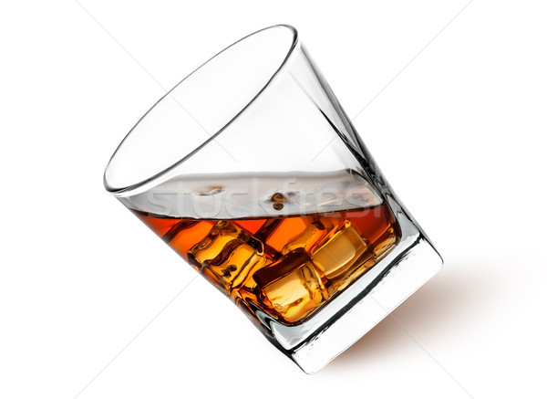 Whiskey with ice in a tilted glass Stock photo © Cipariss