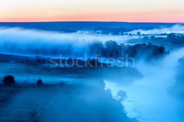 Sunrise fiume nebbia riempimento letto Foto d'archivio © Cipariss